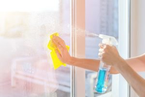 hands-with-napkin-cleaning-window